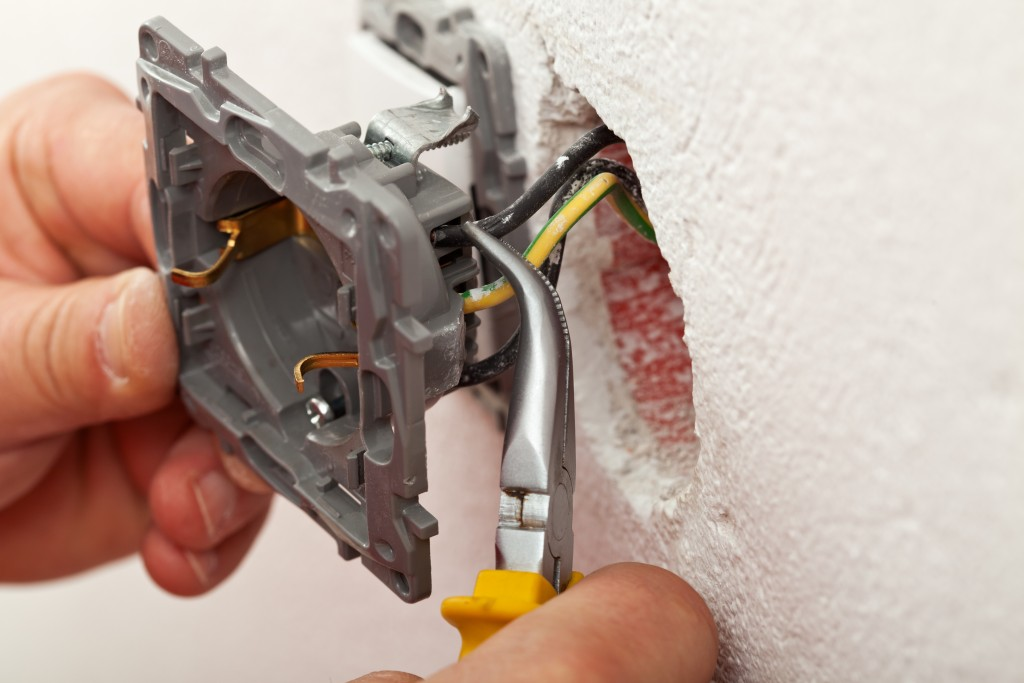 Electrician expert wiring plug socket